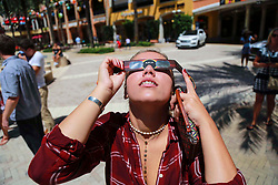 August 21, 2017 - Florida, U.S. - Nadja Ivanovic of West Palm Beach observes the eclipse at CityPlace in West Palm Beach Monday, August 21, 2017. ''It is really cool,'' she said. (Credit Image: © Bruce R. Bennett/The Palm Beach Post via ZUMA Wire)