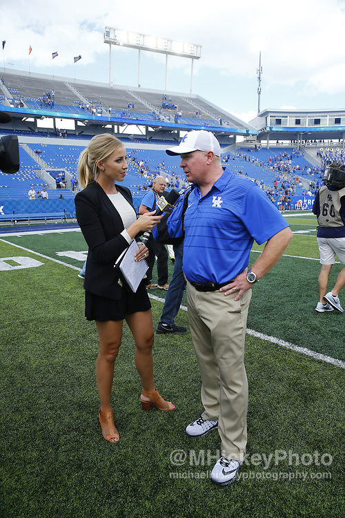 LEXINGTON, KY - SEPTEMBER 09: SEC Network sideline  reporter Olivia Harlan interviews Head coach Mark Stoops of the Kentucky Wildcats after the game against the Eastern Kentucky Colonels at Kroger Field on September 9, 2017 in Lexington, Kentucky. (Photo by Michael Hickey/Getty Images) *** Local Caption *** Mark Stoops; Olivia Harlan