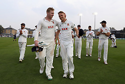 Essex's Simon Harmer and Jamie Porter during a celebratory walk around after day three of the Specsavers County Championship, Division One match at the Cloudfm County Ground, Chelmsford.