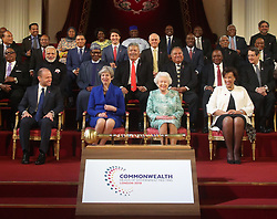 (front row left to right) Prime Minister of Malta Joseph Muscat, Prime Minister Theresa May, Queen Elizabeth II and Commonwealth Secretary-General Patricia Scotland during a group photograph with the other Commonwealth leaders at the formal opening of the Commonwealth Heads of Government Meeting in the ballroom at Buckingham Palace, London.