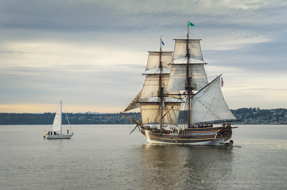 Lady Washington at sail in Semiahmoo Bay, Washington. City of White Rock British Columbia is in the distance. Lady Washington is a historic replica of the original 18th Century brig. Owned and operated by the Grays Harbor Historical Seaport, Aberdeen, Washington.