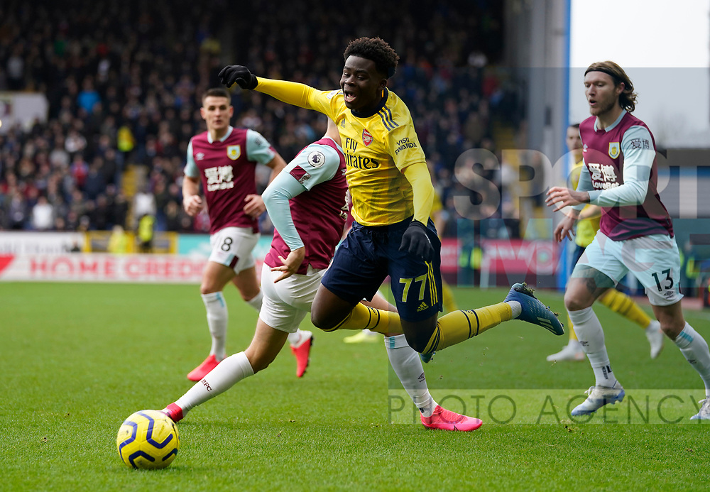 Bukayo Saka of Arsenal is tackled and brought down by Matthew Lowton of Burnley during the Premier League match at Turf Moor, Burnley. Picture date: 2nd February 2020. Picture credit should read: Andrew Yates/Sportimage