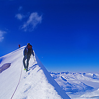 Mountaineers Conrad Anker and the late Alex Lowe ascend the east ridge of Mount Bearskin, above the Patton Glacier in Antarctica's Ellsworth Mountains.