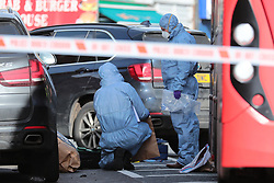 © Licensed to London News Pictures. 09/02/2019. London, UK. Forensics officers at a crime scene on the junction of Lewisham Road and Blackheath Hill in southeast London where a man was shot by police. Photo credit: Rob Pinney/LNP