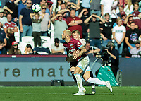 Football - 2018 / 2019 Premier League - West Ham United vs. Manchester United<br /> <br /> Scott McTominay (Manchester United) has arms around Marko Arnautovic (West Ham United) to prevent him reaching the ball at the London Stadium<br /> <br /> COLORSPORT/DANIEL BEARHAM