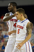 Patric Young (4) and Scottie Wilbekin (5) of the University of Florida Gators celebrate as they walk towards their bench during a timeout against the Florida Gulf Coast University Eagles during the NCAA South Regionals at Cowboys Stadium in Arlington on Friday, March 29, 2013. (Cooper Neill/The Dallas Morning News)