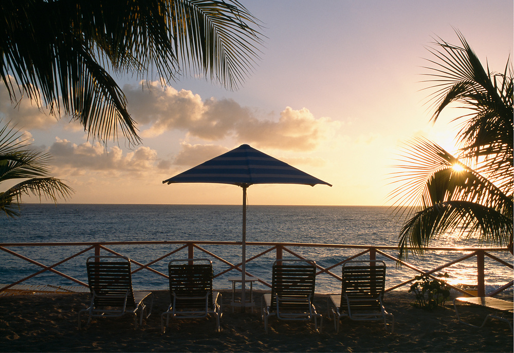 Sunset with beach umbrellas and chairs, Saint-Martin, France