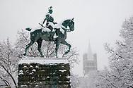 equestrian statue at the Hohenzollernbridge, the romanesque church Gross St. Martin, snow, winter, Cologne, Germany.<br /> <br /> Reiterdenkmal an der Hohenzollernbruecke, Kirche Gross St. Martin, Schnee, Winter, Koeln, Deutschland.