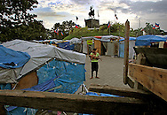 At Champ de Mars camp in downtown Port-au-Prince the temporary tents are becoming a shanty town. Residents use scrap wood to build more permanent structures lined by concrete on the bottom to keep water from infiltrating their home on May 25, 2010..