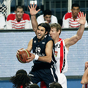 Anadolu Efes's Sasha Vujacıc (C) during their Turkish Basketball League match Anadolu Efes between Bandirma Kirmizi at Sinan Erdem Arena in Istanbul, Turkey, Saturday, December 24, 2011. Photo by TURKPIX