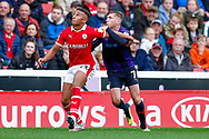 Barnsley forward Jacob Brown (33) battles withLuton Town midfielder Jack Stacey (7)    during the EFL Sky Bet League 1 match between Barnsley and Luton Town at Oakwell, Barnsley, England on 13 October 2018.
