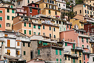 Land is sparce next to the sea in Riomaggiore, Italy.  Homes have been built on top of each other for centuries.