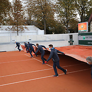 PARIS, FRANCE September 25.  Ground staff put the covers on an outside court during a rainy day at the 2020 French Open Tennis Tournament at Roland Garros on September 25th 2020 in Paris, France. (Photo by Tim Clayton/Corbis via Getty Images)