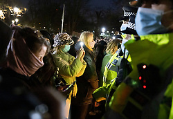 © Licensed to London News Pictures. 13/03/2021. London, UK. Police attempt to break up a vigil for Sarah Everard at the bandstand on Clapham Common. Metropolitan Police officer Wayne Couzens has been charged with the kidnap and murder of Sarah Everard, who went missing as she walked across Clapham Common in south London. The 33-year-old's body was found in Kent just over a week later. Photo credit: Peter Macdiarmid/LNP