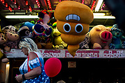 WASHINGTON, USA - August 19: One of the many prizes that can be won from the games at the Montgomery County Agricultural Fair hangs from an awning as people walk by in Gaithersburg, Md., USA on August 19, 2017.