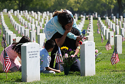 May 27, 2019 - Los Angeles, California, U.S. - A family pays respect to fallen soldiers during an observance for Memorial Day at the Los Angeles National Cemetery. Californians are paying their respects on Memorial Day to those who have died serving their country. (Credit Image: © Jason Ryan/ZUMA Wire).