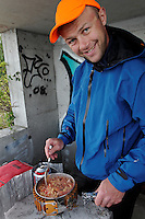 Man coocking dinner at Kjøkøy Fort - mann lager middag, Kjøkøy Fort, Hvaler, Østfold