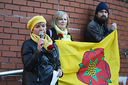 "Councillor Miranda Cox speaks in support of the defendants. Outside Preston Crown Court family, friends and supporters have gathered to a quiete and respectful show of solidarity using roses to symbolise the Lancashire Rose September 25th, Preston, Lancashire, United Kingdom. Simon Roscoe Blevins, 26,  Richard Roberts, 36 were both sentenced 16 months in prison, Richard Loizou, 31, sentenced 15 months in prison and  and Julian Brock, 47 12 months supended. Simon Roscoe Blevins, 26,  Richard Loizou, 31, Richard Roberts, 36 and Julian Brock, 47 climbed on top of several trucks during a mass protest by locals and supporters in New Preston Road, against fracking in Lancashire, July 2017. The trucks were prevented form delivering equipment to Cuadrillas nearby fracking site for four days. After a seven day jury trial at Preston Crown Court in August 2018, the four men were found guilty of Public Nuisance. Judge Altham has told them to expect ""immediate custodial sentences"" on 25th September 2018."
