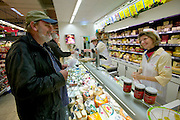 Jörg Melander buys cheese at the Famila supermarket. (Supporting image from the project Hungry Planet: What the World Eats.) The Melander family of Bargteheide, Germany, is one of the thirty families featured, with a weeks' worth of food, in the book Hungry Planet: What the World Eats.