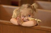 Elli Rose Focht prays at her church on a Sunday morning.