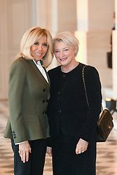 French President's wife Brigitte Macron welcomes Secretary General of the Council of Europe's wife Hanne Grotjord as they take part in a spousal event at the Chateau de Versailles in Versailles, near Paris, on November 11, 2018 as part of commemorations marking the 100th anniversary of the 11 November 1918 armistice, ending World War I. Photo By Laurent Zabulon/ABACAPRESS.COM