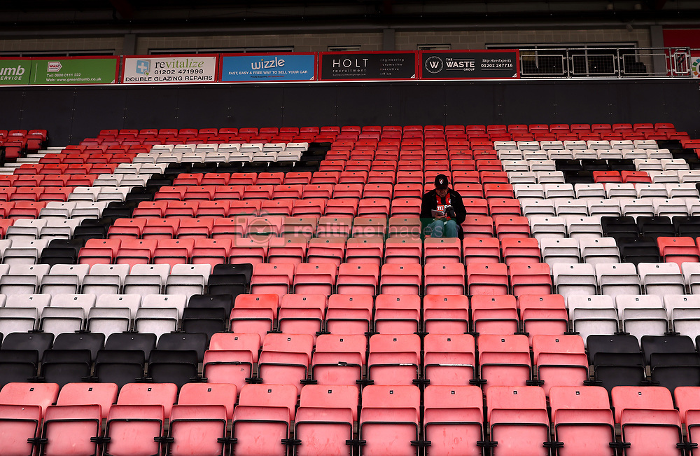 A lone fan in the stands before the Premier League match at the Vitality Stadium, Bournemouth.