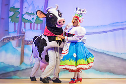 Hackney Empire Theatre, London, November 25th 2015.  Hackney Empire presents Jack and the Beanstalk as their 2015 Christmas pantomime. London's most famous panto will star Hackney Empire's own Olivier nominated dame Clive Rowe as Dame Daisy Trott, Olivier Award-nominated Bodyguard actress Debbie Kurup as Jack and Hackney Panto favourite Kat B as Snowman. Written and directed by Creative Director Susie McKenna, with music by Steven Edis. PICTURED: Clive Rowe as Dame Daisy Trott with Cow.
