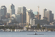 A lone rower takes in the early morning light and the Seattle skyline on Lake Union.<br />