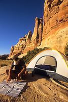 A young man camps in the Needles District of Canyonlands National Park, Utah.