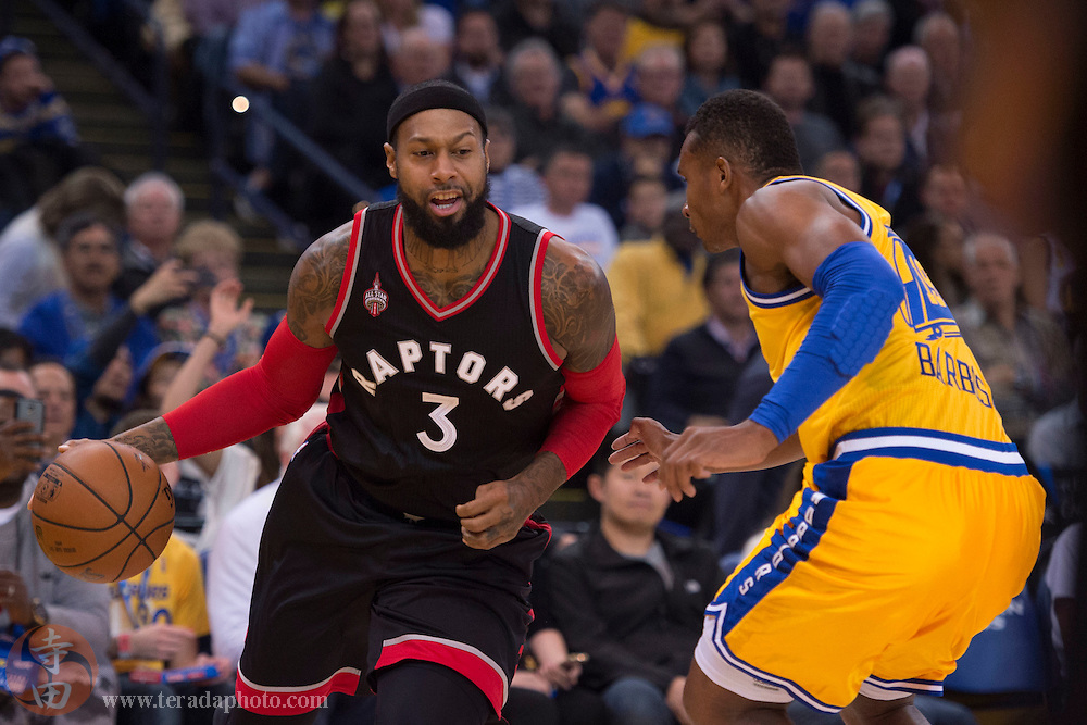 November 17, 2015; Oakland, CA, USA; Toronto Raptors forward James Johnson (3) dribbles the basketball against Golden State Warriors guard Leandro Barbosa (19) during the second quarter at Oracle Arena.