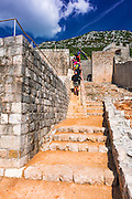 Tourists on the Great Wall above the city center, Ston, Dalmatian Coast, Croatia
