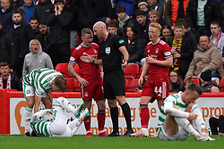 Referee Bobby Madden speaks with Aberdeen's Jonny Hayes after challenges on Celtic players during the cinch Premiership match at Pittodrie Stadium, Aberdeen. Picture date: Sunday October 3, 2021.