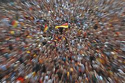 03.07.2010, Hyundai Fan Park, Hamburg, GER, FIFA Worldcup, Puplic Viewing Deutschland vs Argentinien  im Bild Fans mit Deutschland-Outfit beim Zuschauen vor der Tribuene gezoomt.Foto ©  nph /  Witke