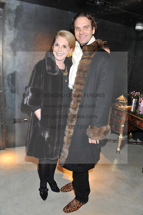 CATHERINE SHRIRO and MICHELE CODONI at a private view of jewellery by Eugenie Nairchos and Noor Fares entitled Galactic Garden held at Shizaru Mayfair, 112 Mount Street, London on 5th December 2012.