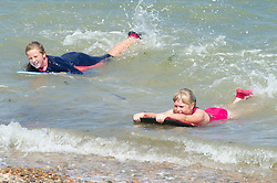 ©Licensed to London News Pictures 06/08/2020     <br /> Minster-on-sea, UK. Two girls surfing in the sea. (ltr) Lauren age 8 and Bella age 9 in pink. Hot sunny weather today as people visit the beach at Minster-on-sea, Isle of sheppey in Kent. Photo credit: Grant Falvey/LNP