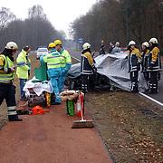 Ongeval met beknelling Crailoseweg Huizen, brandweer, ambulance, chaos, schade, brancard