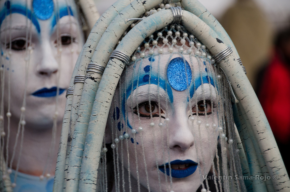 Face of an actress of the group Carros de Foc dressed as a jellyfish at Madrid's Carnival parade.