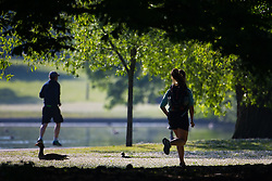 Gese rest on the daisy lawns and runners enjoy the warm weather as a beautiful morning greets Londoners in Regents Park. London, May 09 2018.
