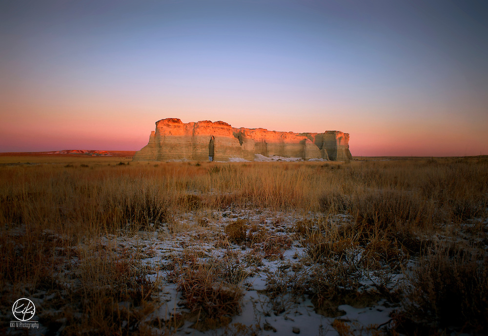 """{Kansas : 2014} """"We need to get there early because there are going to be a lot of people photographing it"""" ---Said I a couple hours before we pulled up on the completely deserted location. Monument Rock was one of our stops on a breezy -10 degree day at sunrise. The wind was at about 15 knots and in between warming our fingers and camera in the car we had a front row show to this beautiful morning on our Nations First Natural Landmark. If the seclusion and nature didn't spark your fancy, imagine standing next to something that has 80 million years of history on you. Imagine the people and things these structures have seen. Humbling to say the lease."""