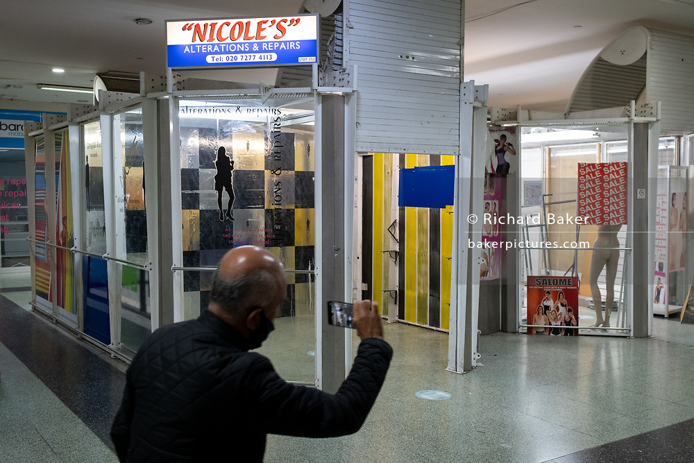 On the day that Elephant & Castle Shopping Centre closes before its demolition and redevelopment, 1960s architecture and retail stock is taken away by shop keepers before doors are locked for the final time after 55 years, on 24th September 2020, in south London, England. The much-criticised architecture of the Elephant & Castle Shopping Centre was opened in 1965, built on the bomb damaged site of the former Elephant & Castle Estate, originally constructed in 1898. The centre was home to restaurants, clothing retailers, fast food businesses and clubs where south Londoners socialised and met lifelong partners.