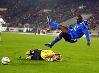Photo: Scott Heavey.<br /> VFB Stuttgart v Chelsea. Champions League Quarter Final First Leg. 25/02/2004.<br /> Jimmy Floyd Hasselbaink is sent flying by Timo Hildebrand
