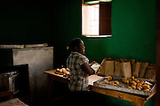 Members of the Magnificent Cooperative in  the Nyamagabe District of Rwanda's Southern Province prepare bread for the day. The bread co-op provides vocational training in baking to students who are unable to continue their education in either high school or college, and is comprised of orphans and vulnerable children. The co-op is part of the Mudasomwa Area Development Program (ADP) and is one of many long-term development initiatives led by the international nonprofit World Vision. Area Development Programs work within communities like Nyamagabe over a period of several years, providing developmental resources to foster long-term, sustainable growth in the economic and physical well being of the community.