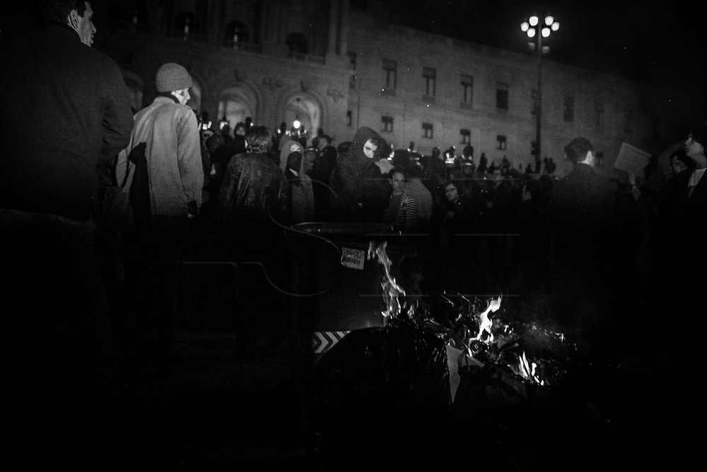 People vigil in protest outside the Portuguese parliament in Lisbon against austerity, further government cuts, large scale public sector privatization and layoffs, and increasing taxation over food and utilities.