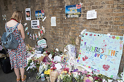 © Licensed to London News Pictures. 20/06/2017. London, UK. A woman looks at tributes near Finsbury Mosque in north London after a van ploughed into a crowd nearby. One person has been killed and 10 people are injured. Darren Osborne, 47, from Cardiff, continues to be held on suspicion of attempted murder and alleged terror offences.  Photo credit: Peter Macdiarmid/LNP
