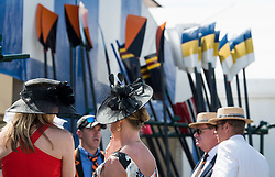 © Licensed to London News Pictures. 04/07/2018. Henley-on-Thames, UK. People wear elaborate hats on Day one of the Henley Royal Regatta, set on the River Thames by the town of Henley-on-Thames in England. Established in 1839, the five day international rowing event, raced over a course of 2,112 meters (1 mile 550 yards), is considered an important part of the English social season. Photo credit: Ben Cawthra/LNP