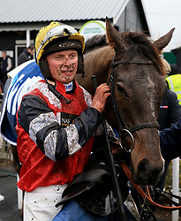 Jockey James Bowen with Potters Corner after winning the Marstons 61 Deep Midlands Grand National race at Uttoxeter Racecourse.