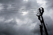 Men working on electric lines in Tamale, Ghana, on Sunday June 3, 2007.
