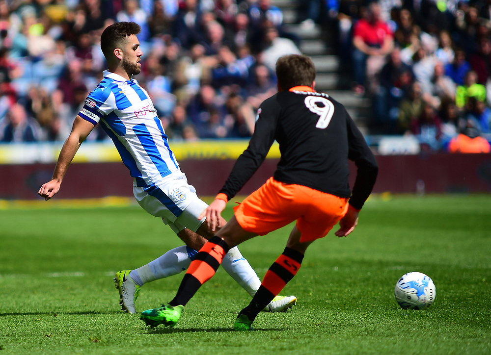 Huddersfield Town's Tommy Smith lays the ball off, under pressure from Sheffield Wednesday's Adam Reach<br /> <br /> Photographer Andrew Vaughan/CameraSport<br /> <br /> The EFL Sky Bet Championship Play-Off Semi Final First Leg - Huddersfield Town v Sheffield Wednesday - Saturday 13th May 2017 - The John Smith's Stadium - Huddersfield<br /> <br /> World Copyright © 2017 CameraSport. All rights reserved. 43 Linden Ave. Countesthorpe. Leicester. England. LE8 5PG - Tel: +44 (0) 116 277 4147 - admin@camerasport.com - www.camerasport.com