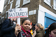 Protesters against the LD50 gallery, January 25th 2017, Hackney, Unted Kingdom. The anti-fascist activists hold up posters denouncing the gallery, accusing the gallery of supporting far right fascist policies.
