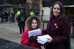 London, UK. 22 January, 2020. Elizabeth Cairns, author of 'The Empowered Entrepreneur' and Extinction Rebellion member, arrives at Parliament with her daughter, other campaigners seeking to protect ancient woodland and wildlife threatened by the HS2 high-speed rail link and letters from other campaigners opposed to HS2 to lobby MPs to speak out against and push for an immediate halt to works for the huge infrastructure project. Cost projections for the project, which would destroy or irreparably damage 108 ancient woodlands, are reported to have risen to £106bn and the Government is expected to make a decision about its viability in February.